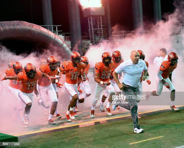 Head coach Tony Sanchez of the UNLV Rebels takes the field with his players before their game against the San Jose State Spartans at Sam Boyd Stadium...