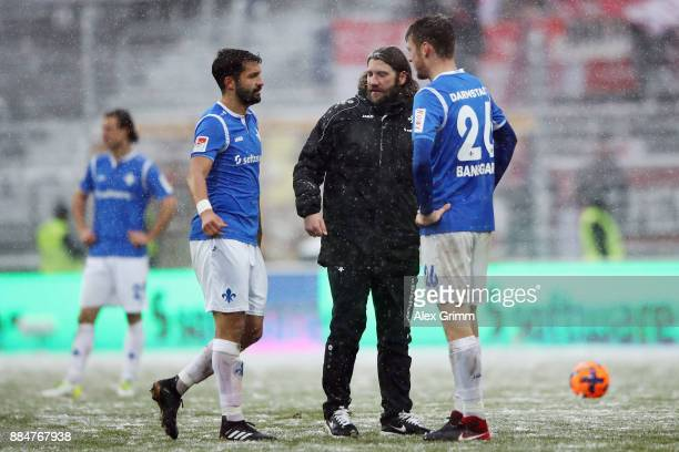 Head coach Torsten Frings, Aytac Sulu and Patrick Banggaard of Darmstadt react after the Second Bundesliga match between SV Darmstadt 98 and SSV Jahn...