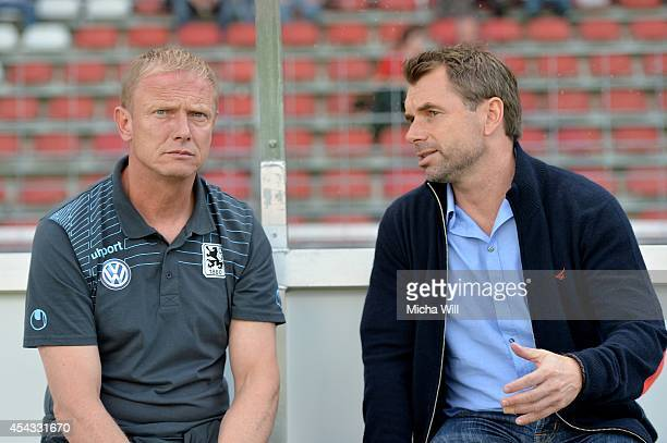 Head coach Torsten Froehling of Muenchen talks to Head coach Bernd Hollerbach of Wuerzburg prior to the Regionalliga Bayern match between Wuerzburger...