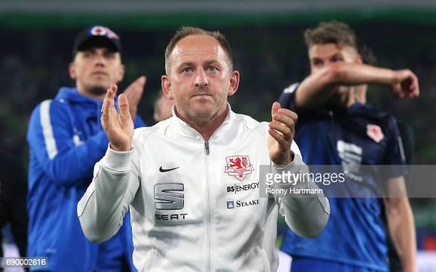 Head coach Torsten Lieberknecht of Braunschweig applauds the supporters after the Bundesliga Playoff first leg match between VfL Wolfsburg and...