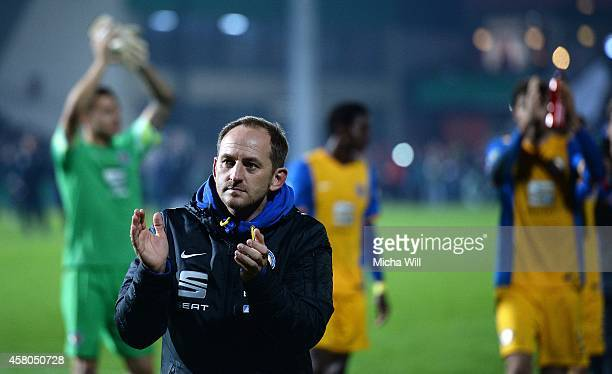 Head coach Torsten Lieberknecht of Braunschweig celebrates his teams victory in the DFB Cup second round match between Wuerzburger Kickers and...