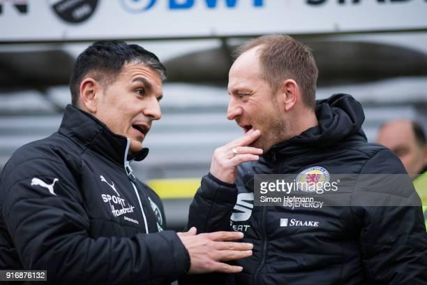 Head coach Torsten Lieberknecht of Braunschweig chats with Head coach Kenan Kocak of Sandhausen prior to the Second Bundesliga match between SV...
