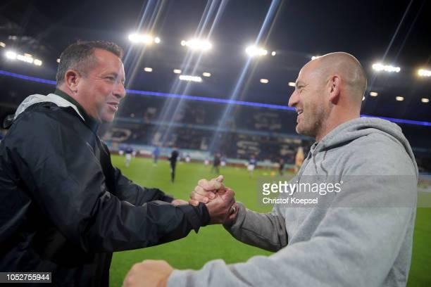 Head coach Torsten Lieberknecht of Duisburg and head coach Marc Kauczinski of St Pauli shake hands prior to the Second Bundesliga match between MSV...