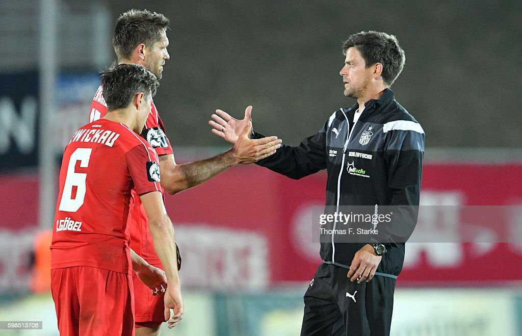 Head coach Torsten Ziegner (R) of Zwickau shakes hands with Ronny Koenig (C) and Christoph Goebel (L) of Zwickau during the Third League match between FSV Zwickau and 1. FC Magdeburg at Stadion Zwickau on September 1, 2016 in Zwickau, Germany.