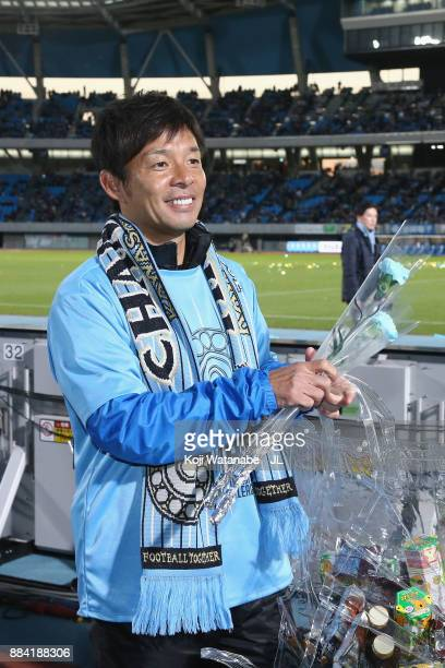 Head coach Toru Oniki of Kawasaki Frontale celebrates his side's JLeague Champios with supporters after the JLeague J1 match between Kawasaki...