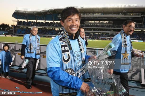 Head coach Toru Oniki of Kawasaki Frontale celebrates his side's J.League Champios with supporters after the J.League J1 match between Kawasaki...