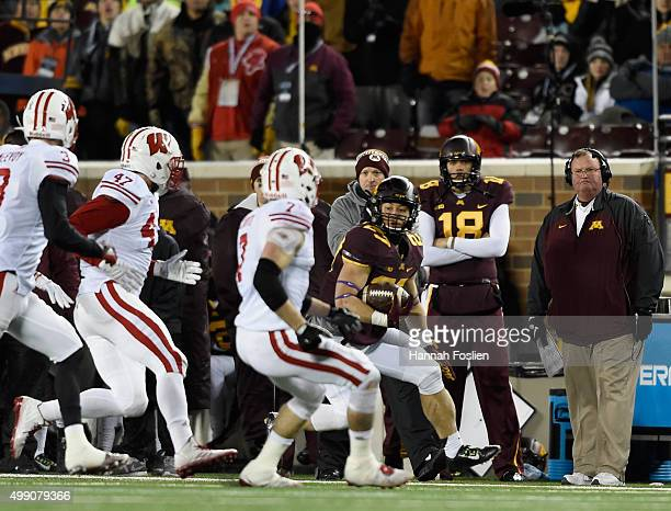 Head coach Tracy Claeys of the Minnesota Golden Gophers looks on as Shannon Brooks carries the ball against the Wisconsin Badgers during the fourth...