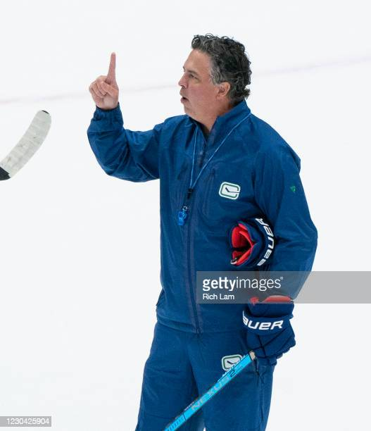 Head coach Travis Green gestures while shouting instructions to the team on the first day of the Vancouver Canucks NHL Training Camp at Rogers Arena...