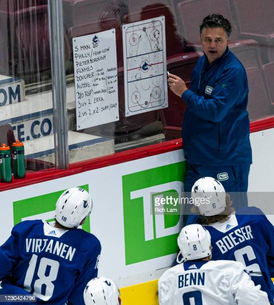 Head coach Travis Green of the Vancouver Canucks draws up a drill on the whiteboard on the first day of the Vancouver Canucks NHL Training Camp at...