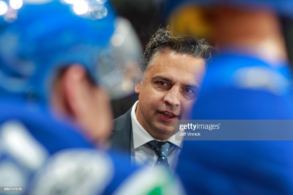 Head coach Travis Green of the Vancouver Canucks looks on from the bench during their NHL game against the Winnipeg Jets at Rogers Arena October 12, 2017 in Vancouver, British Columbia, Canada. The final score was 4-2 for the Winnipeg Jets.