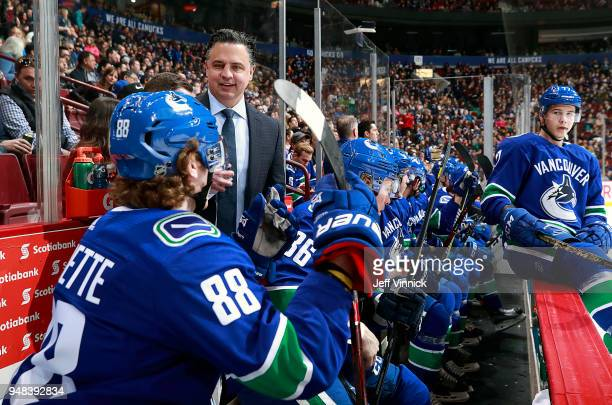 Head coach Travis Green of the Vancouver Canucks talkls to Adam Gaudette of the Vancouver Canucks during their NHL game against the Columbus Blue...
