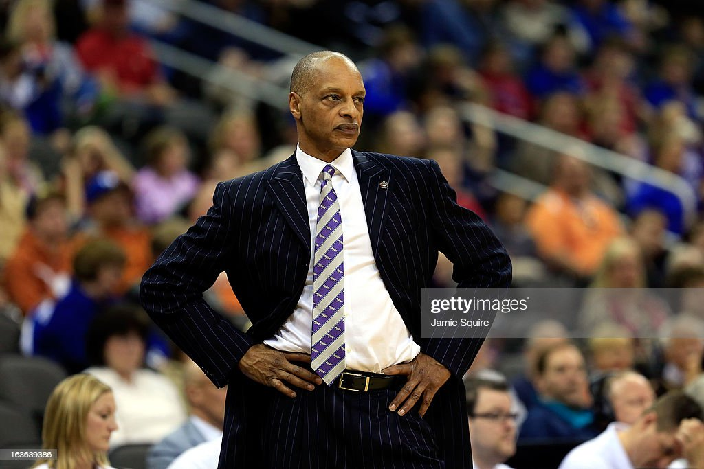 Head coach Trent Johnson of the TCU Horned Frogs watches from the bench during the first round of the 2013 Big 12 Men's Basketball Championship against the Texas Longhorns at Sprint Center on March 13, 2013 in Kansas City, Missouri.
