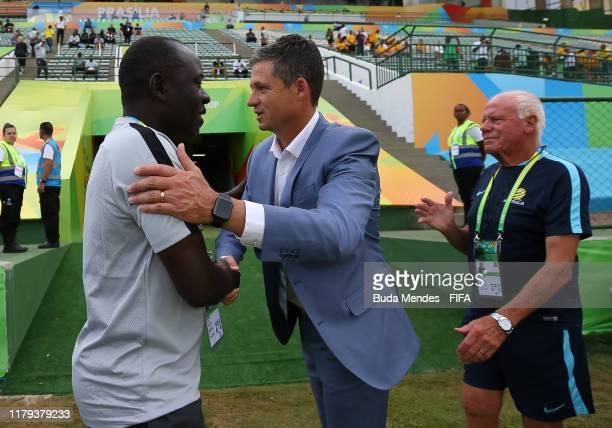 Head coach Trevor Morgan of Australia greets head coach Manu Garba of Nigeria before the FIFA U-17 Men's World Cup Brazil 2019 group B match between...