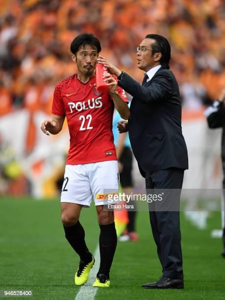 Head coach Tsuyoshi Otsuki of Urawa Red Diamonds speaks to Yuki Abe during the JLeague J1 match between Urawa Red Diamonds and Shimizu SPulse at...