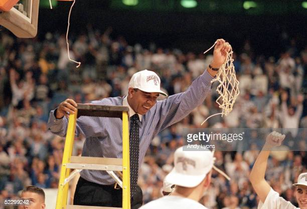 Head coach Tubby Smith of University of Kentucky Wildcats celebrates cutting down the basketball net after winning the 1998 NCAA South Regionals...