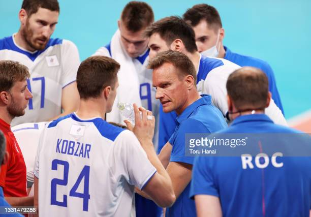 Head Coach Tuomas Sammelvuo of Team ROC reacts with players against Team France during the Men's Preliminary Round - Pool B volleyball on day seven...