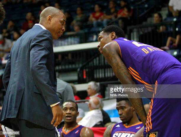 Head coach Ty Ellis of the Northern Arizona Suns talks to player Alex Davis during a time out agaist the Rio Grande Valley Vipers at the State Farm...