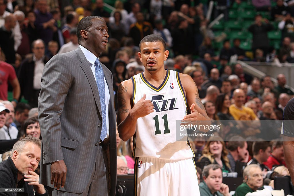 Head Coach Tyrone Corbin and Earl Watson #11 of the Utah Jazz talk things over against the New Orleans Hornets at Energy Solutions Arena on January 30, 2013 in Salt Lake City, Utah.