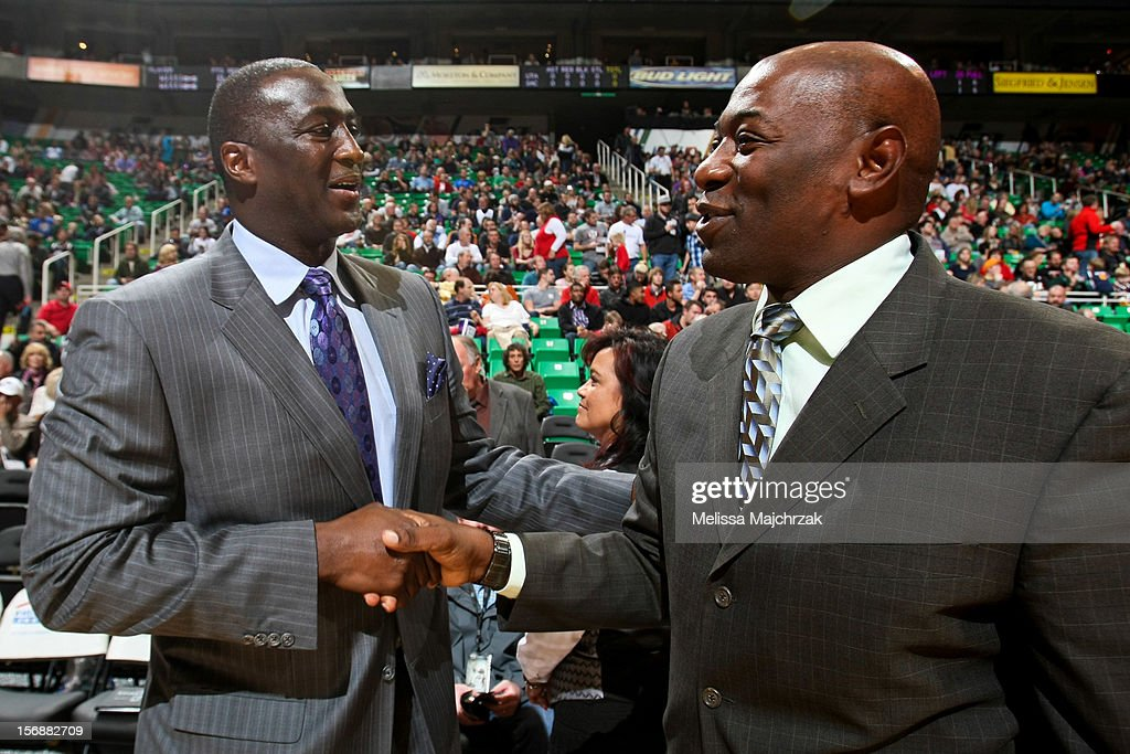 Head Coach Tyrone Corbin of the Utah Jazz and Head Coach Keith Smart of the Sacramento Kings shake hands before their game at Energy Solutions Arena on November 23, 2012 in Salt Lake City, Utah.