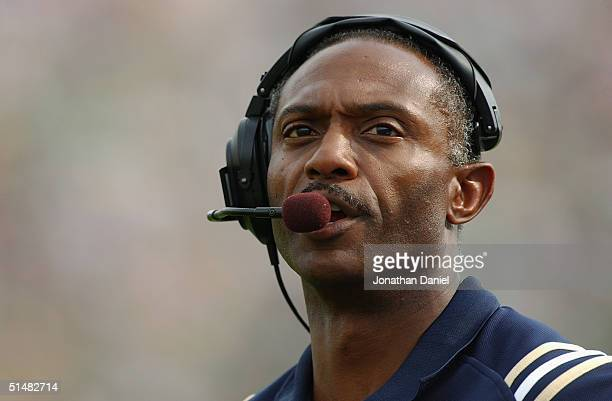 Head coach Tyrone Willingham of the Notre Dame Fighting Irish watches from the sideline during a game with the Michigan Wolverines on September 11...