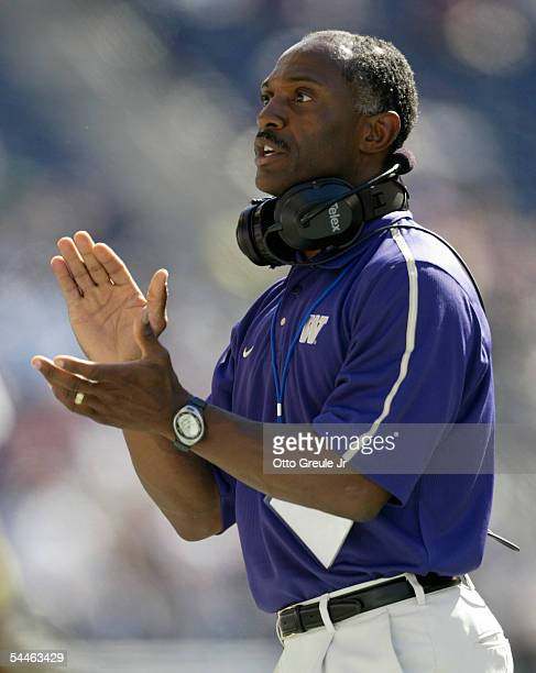 Head Coach Tyrone Willingham of the Washington Huskies claps on the sidelines against Air Force on September 3, 2005 at Quest Field in Seattle,...