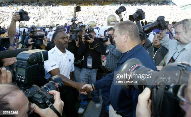 Head Coach Tyrone Willingham of the Washington Huskies shakes hands after the game with Head Coach Charlie Weis of the Notre Dame Fighting Irish on...