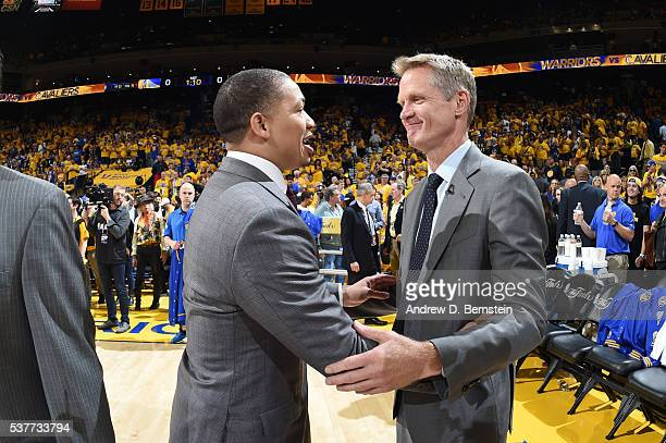 Head Coach Tyronn Lue of the Cleveland Cavaliers exchange greetings with Head Coach Steve Kerr of the Golden State Warriors during Game One of the...