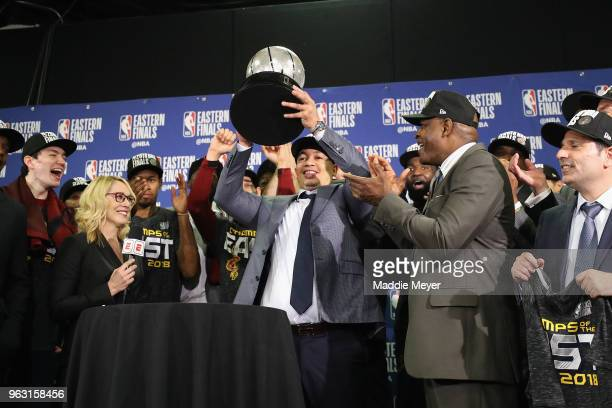 Head coach Tyronn Lue of the Cleveland Cavaliers holds the 2018 NBA Eastern Conference Finals trophy after defeating the Boston Celtics 8779 in Game...