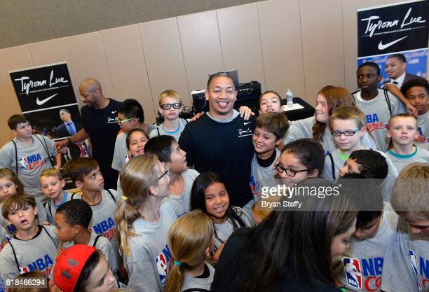 Head Coach Tyronn Lue of the Cleveland Cavaliers poses for a group photo with the youth participants of the Tyronn Lue Fantasy Youth Clinic produced...