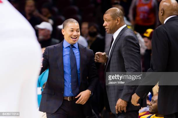 Head coach Tyronn Lue of the Cleveland Cavaliers talks to head coach Doc Rivers of the LA Clippers during the second half at Quicken Loans Arena on...