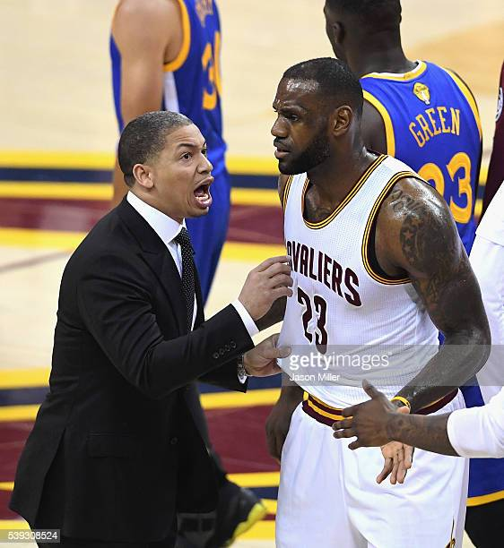 Head coach Tyronn Lue of the Cleveland Cavaliers talks to LeBron James during a break in the action in Game 4 of the 2016 NBA Finals against the...