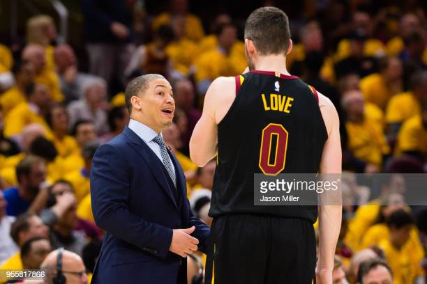 Head coach Tyronn Lue of the Cleveland Cavaliers talks with Kevin Love during the second half of Game 4 of the second round of the Eastern Conference...
