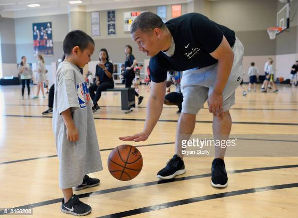 Head Coach Tyronn Lue of the Cleveland Cavaliers works with youth participants on leadership and basketball skills during the Tyronn Lue Fantasy...