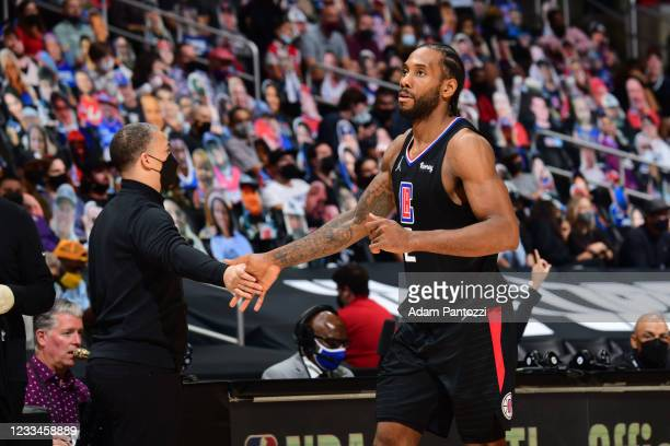 Head Coach Tyronn Lue of the Los Angeles Clippers hi-fives Kawhi Leonard during Round 2, Game 4 of 2021 NBA Playoffs on June 14, 2021 at STAPLES...