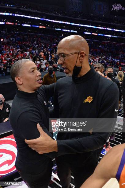Head Coach Tyronn Lue of the Los Angeles Clippers hugs Head Coach Monty Williams of the Phoenix Suns after the game during Game 6 of the Western...