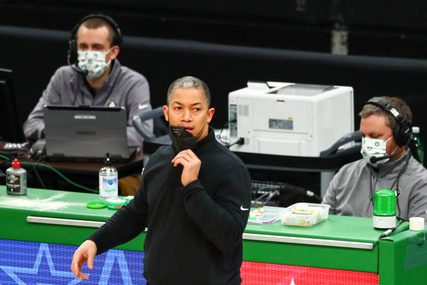 Head coach Tyronn Lue of the Los Angeles Clippers lowers his mask to speak during a game against the Boston Celtics at TD Garden on March 2, 2021 in...