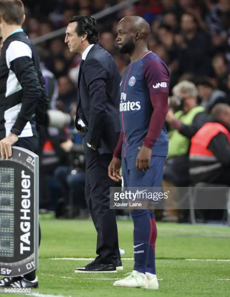 Head coach Unai Emery and Lassana Diarra of Paris SaintGermain look on during the Ligue 1 match between Paris Saint Germain and AS Monaco at Parc des...