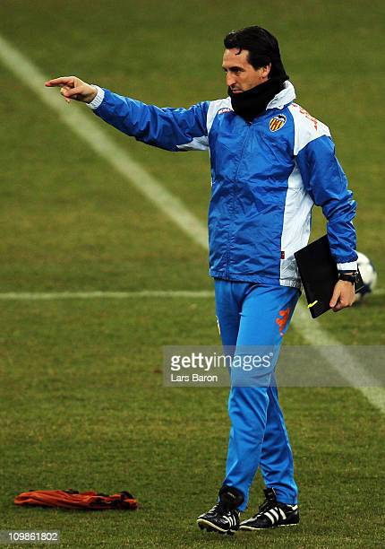 Head coach Unai Emery gestures during a FC Valencia training session ahead of the UEFA Champions League Round of 16 second leg match against FC...