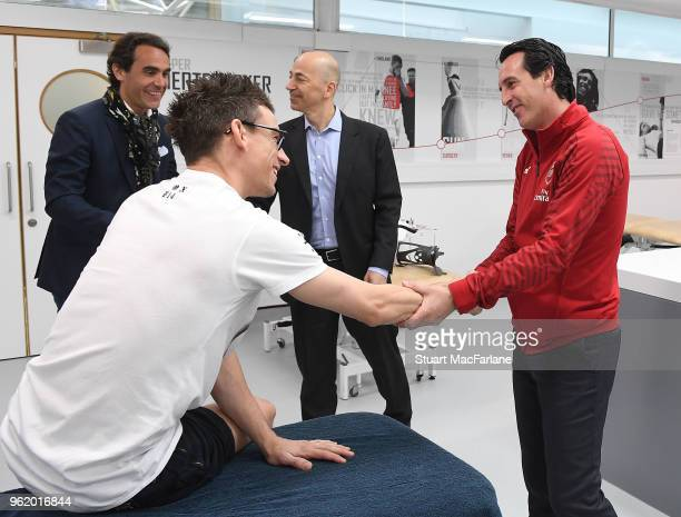 Head Coach Unai Emery meets injured Arsenal cefender Laurent Koscielny at London Colney on May 24, 2018 in St Albans, England.