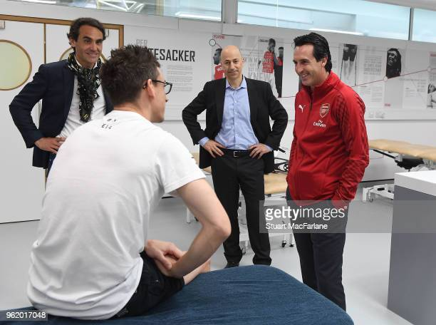 Head Coach Unai Emery meets injured Arsenal defender Laurent Koscielny at London Colney on May 24 2018 in St Albans England