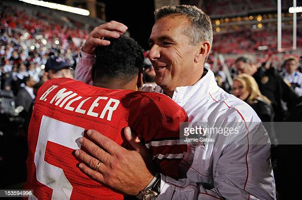 Head Coach Urban Meyer hugs quarterback Braxton Miller of the Ohio State Buckeyes after the Buckeyes defeated the Nebraska Cornhuskers 6338 at Ohio...