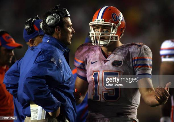 Head coach Urban Meyer of the Florida Gators chats with quarterback Tim Tebow during a game against the Florida State Seminoles at Bobby Bowden Field...