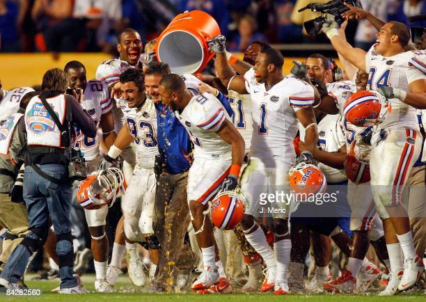 Head coach Urban Meyer of the Florida Gators is doused by his players at the conclusion of the game against the Oklahoma Sooners at the FedEx BCS...