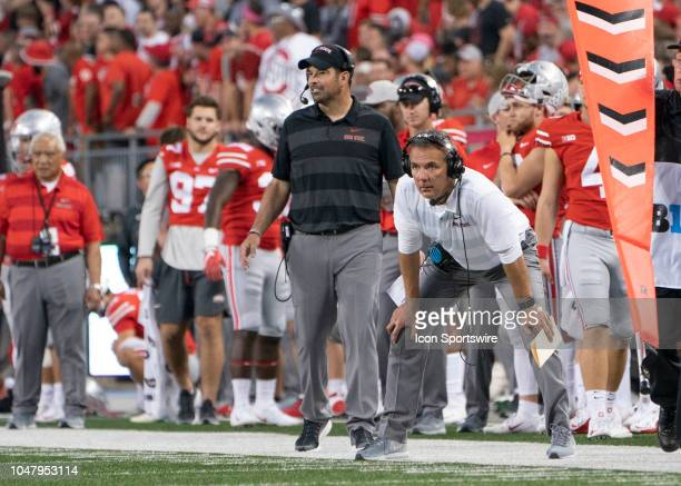 Head coach Urban Meyer of the Ohio State Buckeyes and Offensive Coordinator Ryan Day during the game between the Ohio State Buckeyes and the Indiana...