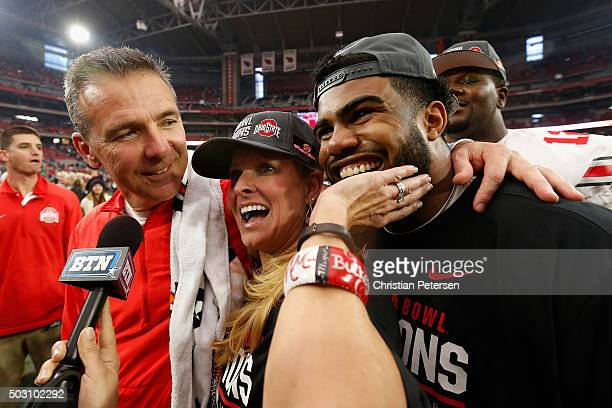Head coach Urban Meyer of the Ohio State Buckeyes celebrates with wife Shelley Mather Meyer and running back Ezekiel Elliott after defeating the...