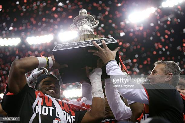 Head coach Urban Meyer of the Ohio State Buckeyes celebrates with the trophy after defeating the Alabama Crimson Tide in the All State Sugar Bowl at...