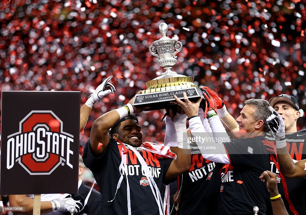 Head coach Urban Meyer of the Ohio State Buckeyes celebrates with the trophy after defeating the Alabama Crimson Tide in the All State Sugar Bowl at the Mercedes-Benz Superdome on January 1, 2015 in New Orleans, Louisiana. The Ohio State Buckeyes defeated the Alabama Crimson Tide 42 to 35.