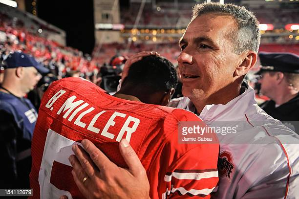 Head Coach Urban Meyer of the Ohio State Buckeyes congratulates quarterback Braxton Miller of the Ohio State Buckeyes after their 63-38 victory over...