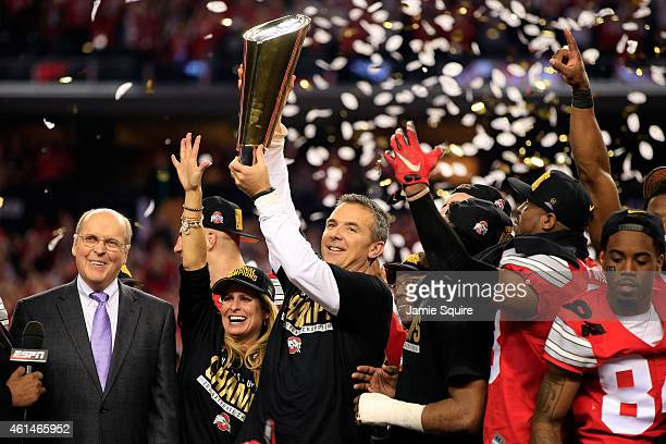Head Coach Urban Meyer of the Ohio State Buckeyes hoist the trophy after defeating the Oregon Ducks 42 to 20 in the College Football Playoff National...