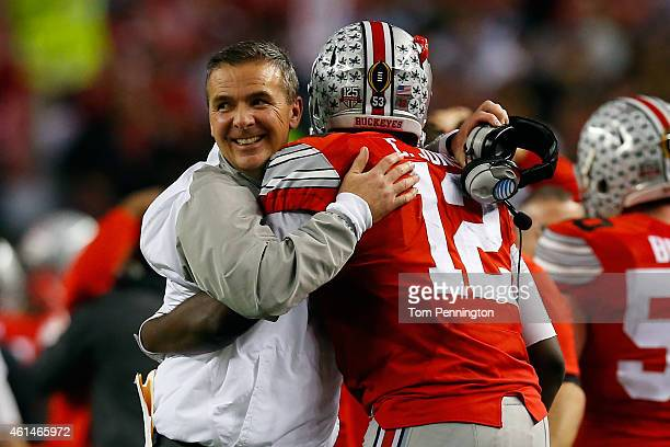 Head Coach Urban Meyer of the Ohio State Buckeyes hugs Quarterback Cardale Jones in the fourth quarter against the Oregon Ducks during the College...